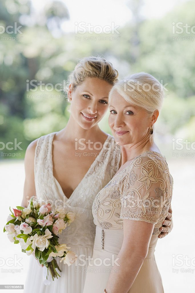 Mother and bride hugging royalty-free stock photo