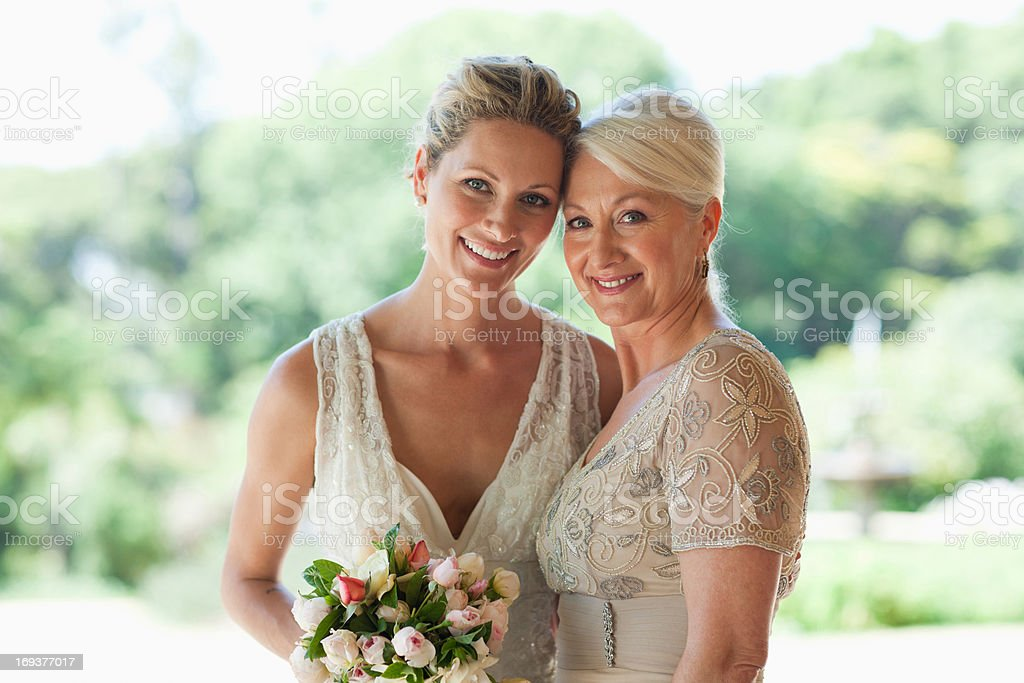 Mother and bride hugging stock photo