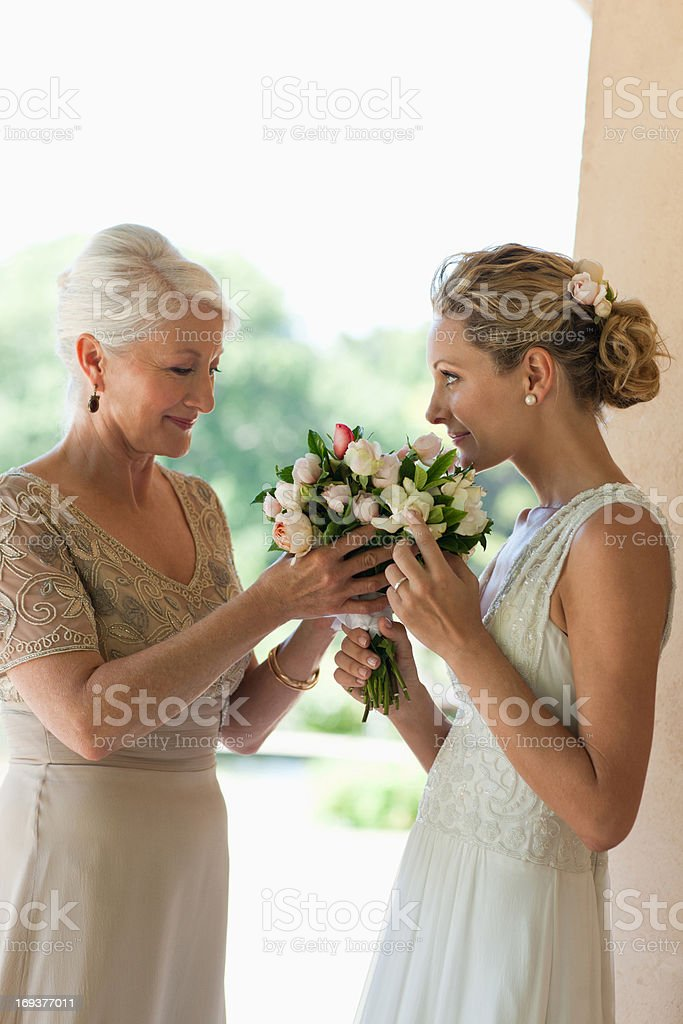 Mother and bride smelling bouquet royalty-free stock photo