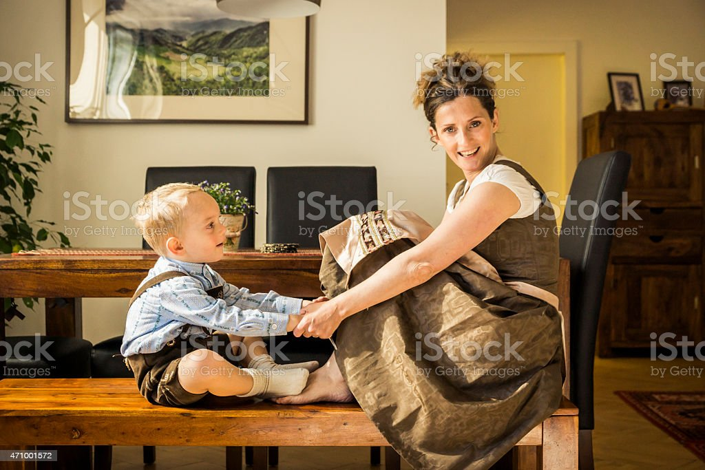 Mother and Child at Home in Traditional Austrian Clothing stock photo