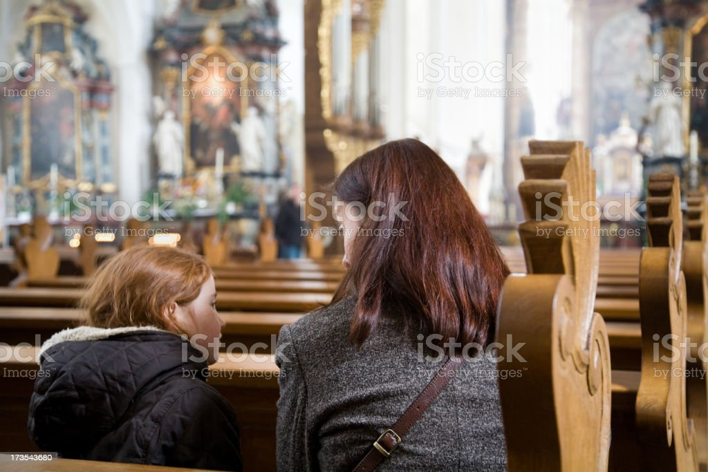 Mother and child at the church stock photo