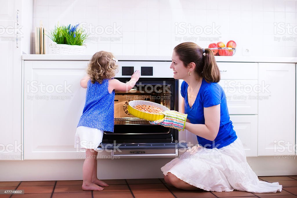 Mother and child baking a cake. stock photo