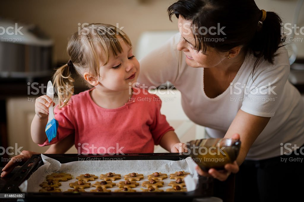 Mother and child baking together stock photo
