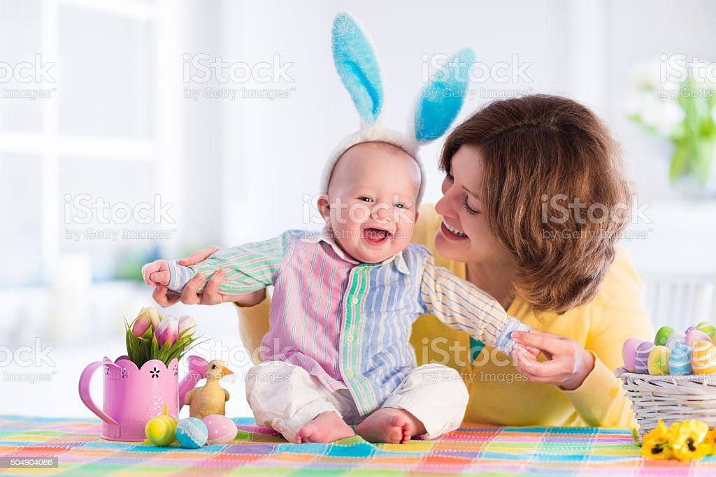 Mother and child celebrating Easter at home stock photo