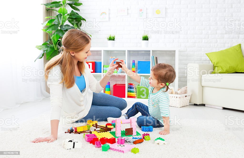 Mother and child daughter playing, build from constructor stock photo