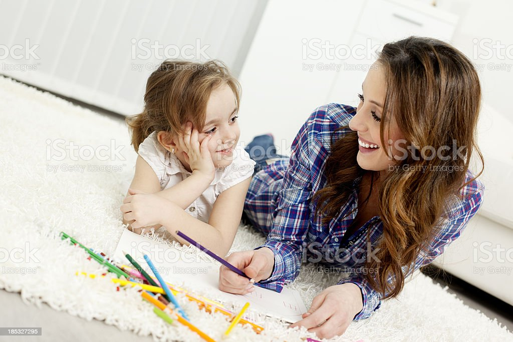 Mother and child drawing coloring book. royalty-free stock photo