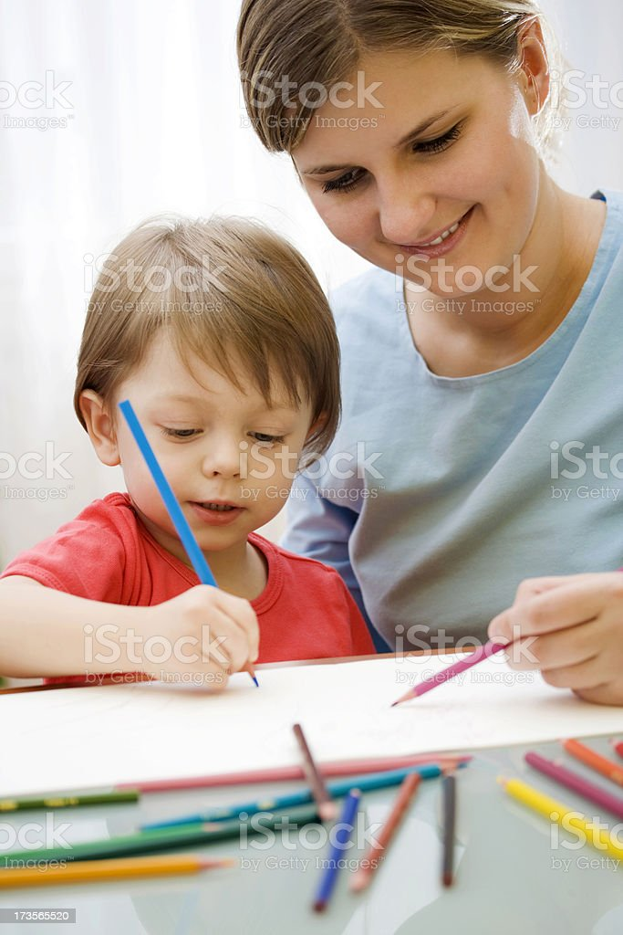 Mother and child drawing together royalty-free stock photo