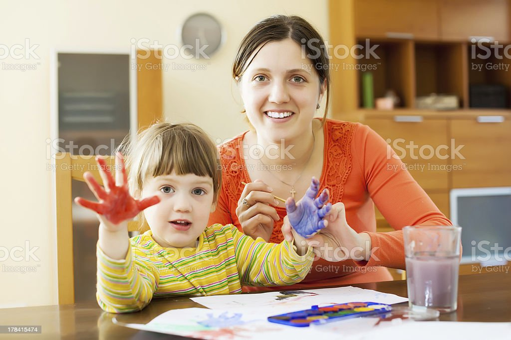mother and  child drawing with hand printing royalty-free stock photo