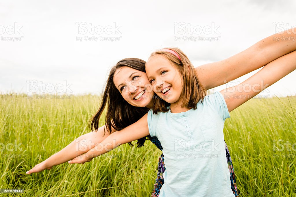 Mother and child flying stock photo