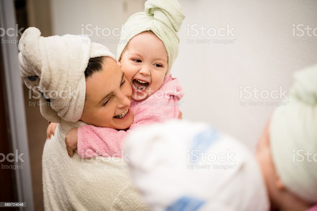 Mother and child - fun in bathrobes stock photo