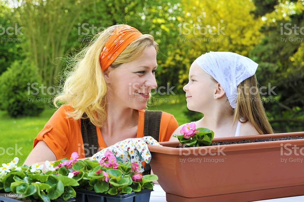 Mother and child - gardening royalty-free stock photo