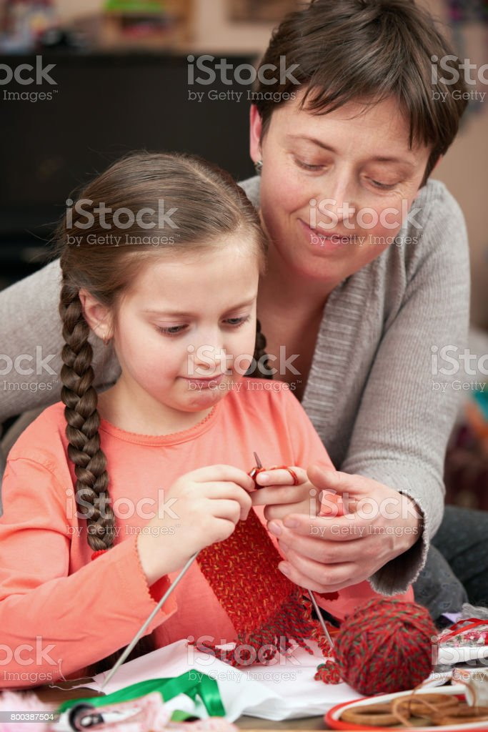 mother and child girl knit, handmade and handicraft concept stock photo