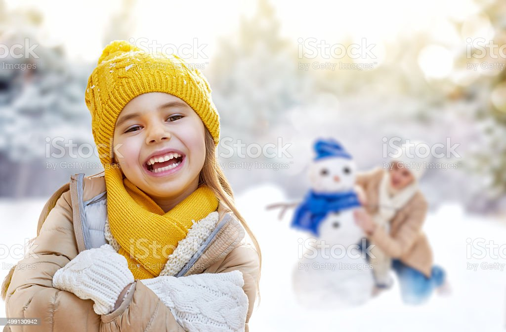Mother and child girl on a winter walk stock photo