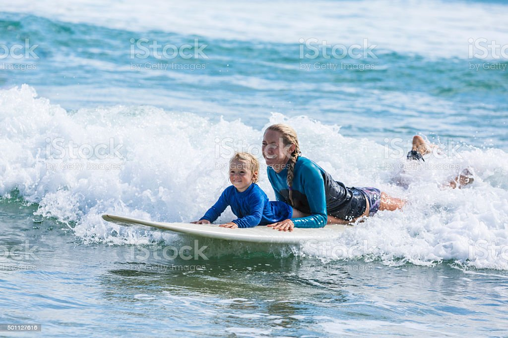 Mother and Child Going Surfing at the Beach stock photo