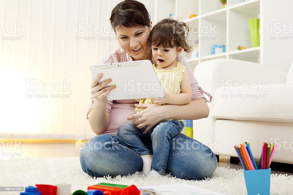 Mother and child having fun with digital tablet. royalty-free stock photo