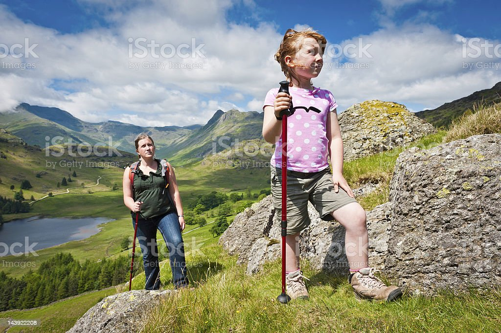 Mother and child hiking in picturesque mountains stock photo