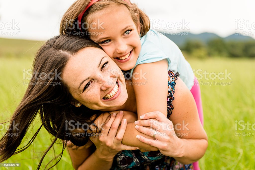 Mother and child hugging stock photo
