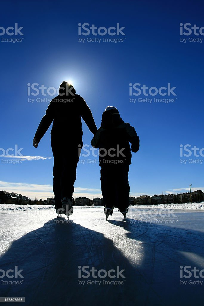 Mother and Child Ice Skating Silhouette stock photo