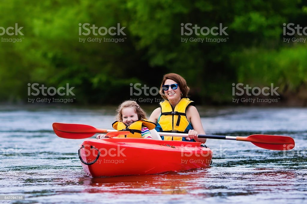 Mother and child in a kayak stock photo
