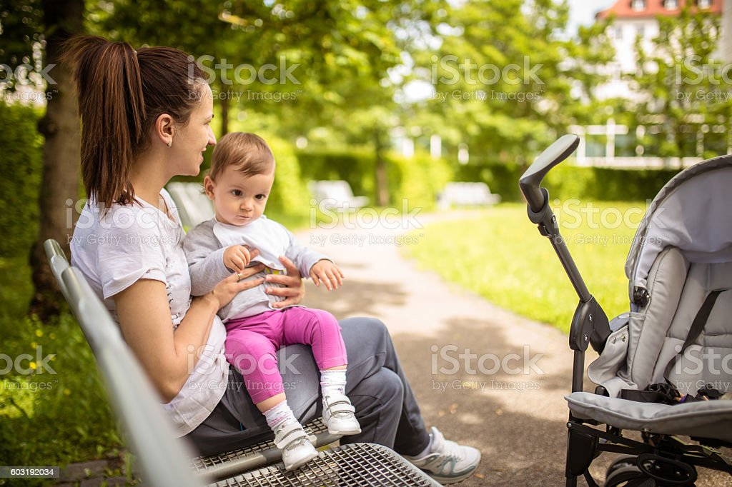 Mother and child in a park stock photo