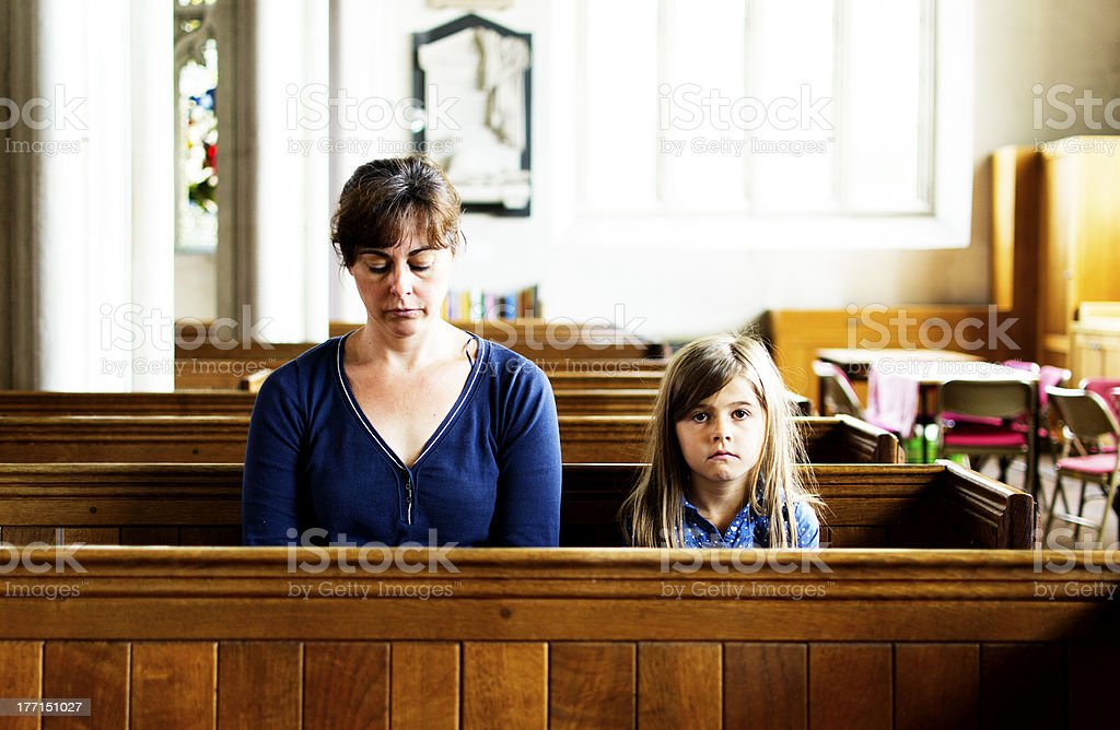 Mother and child in church stock photo