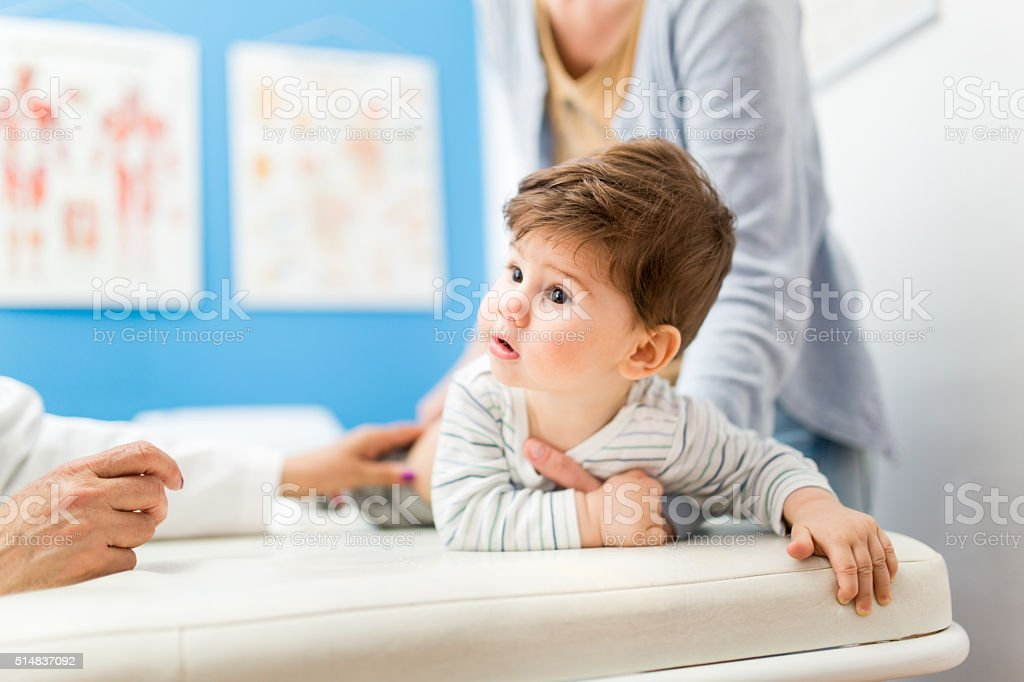 Mother and child in doctor's office stock photo