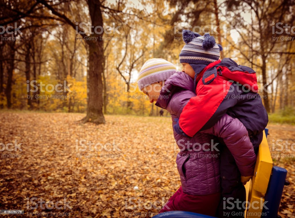 Mother and child in the park in autumn day stock photo