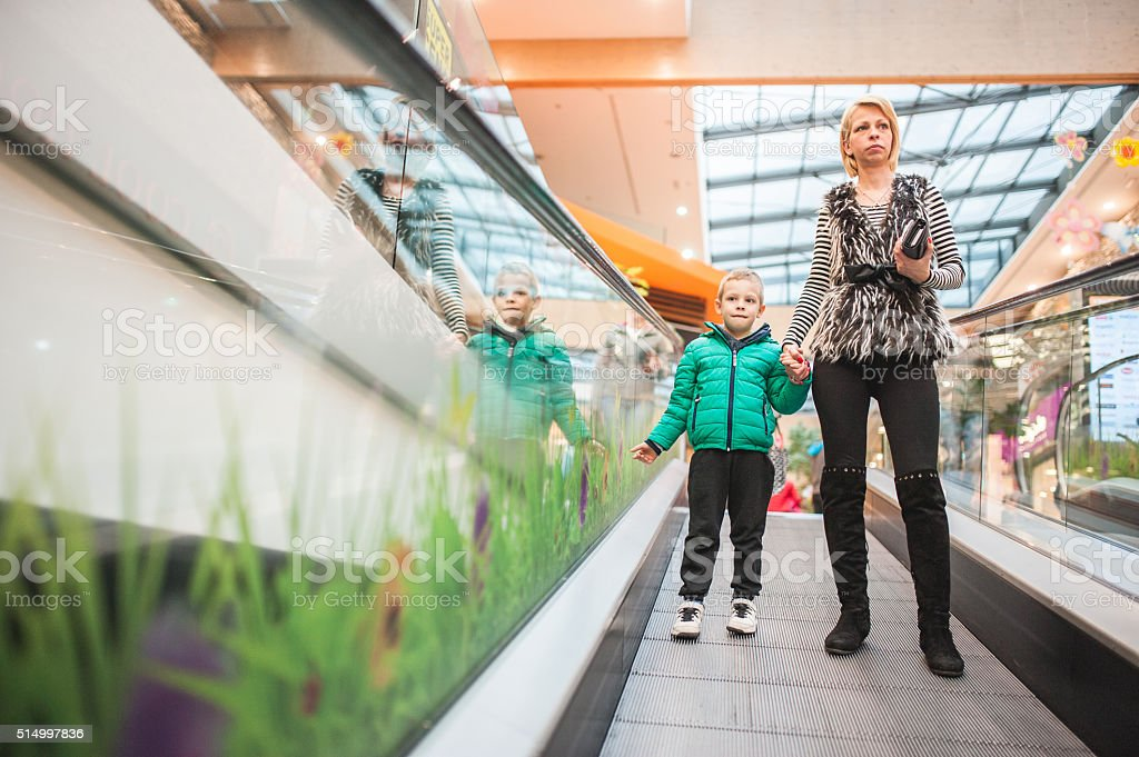 Mother and Child Leaving from Toy Shop stock photo