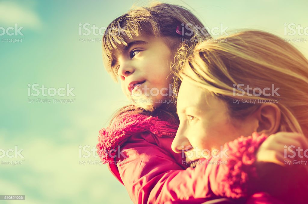 Mother and child looking to the future stock photo