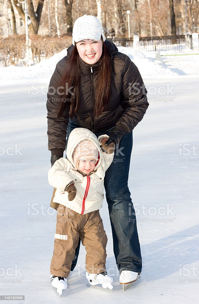 Mother and child on the rink royalty-free stock photo