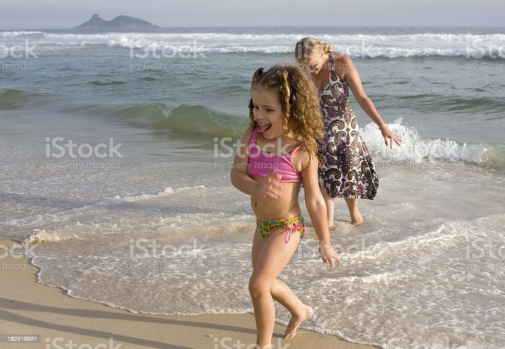 Mother and Child Playing on the Beach. royalty-free stock photo