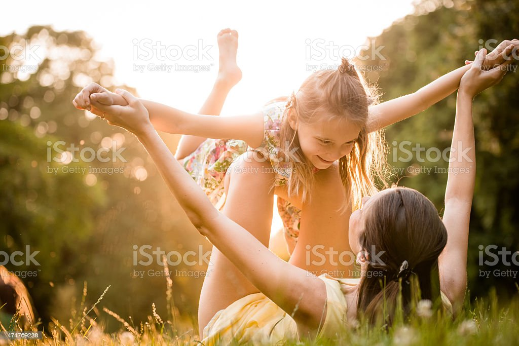 Mother and child playing stock photo