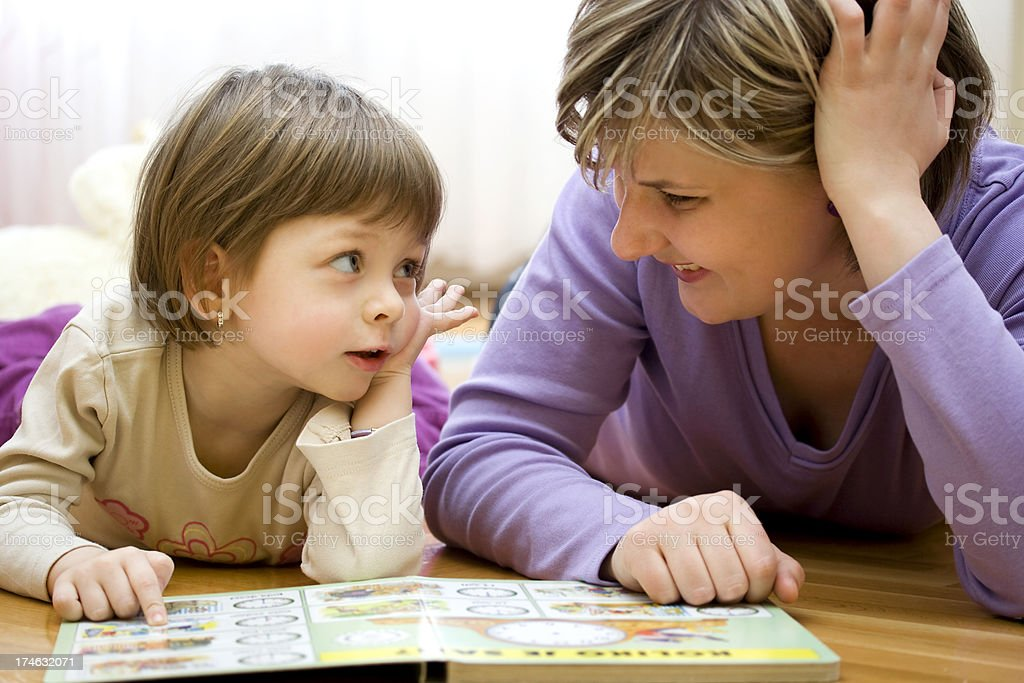 Mother and child reading picture book stock photo