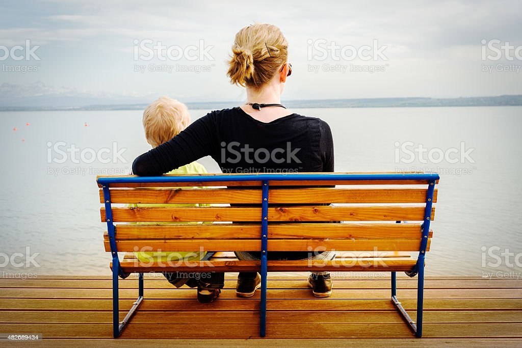 mother and child resting at Lake Constance stock photo