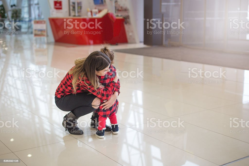 mother and child reunited stock photo