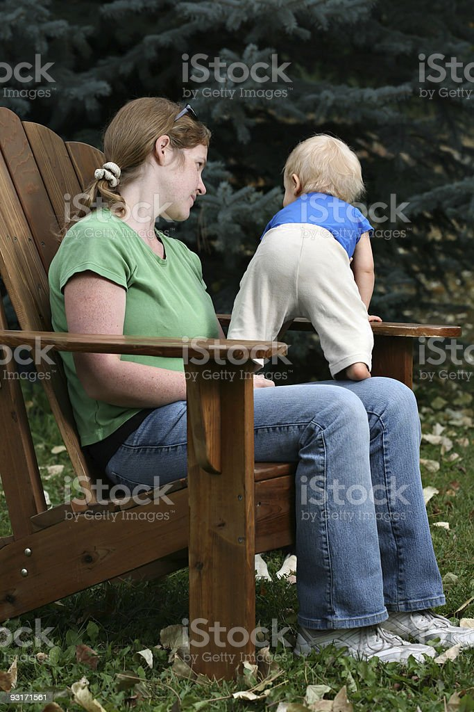 Mother and child sitting outdoors royalty-free stock photo