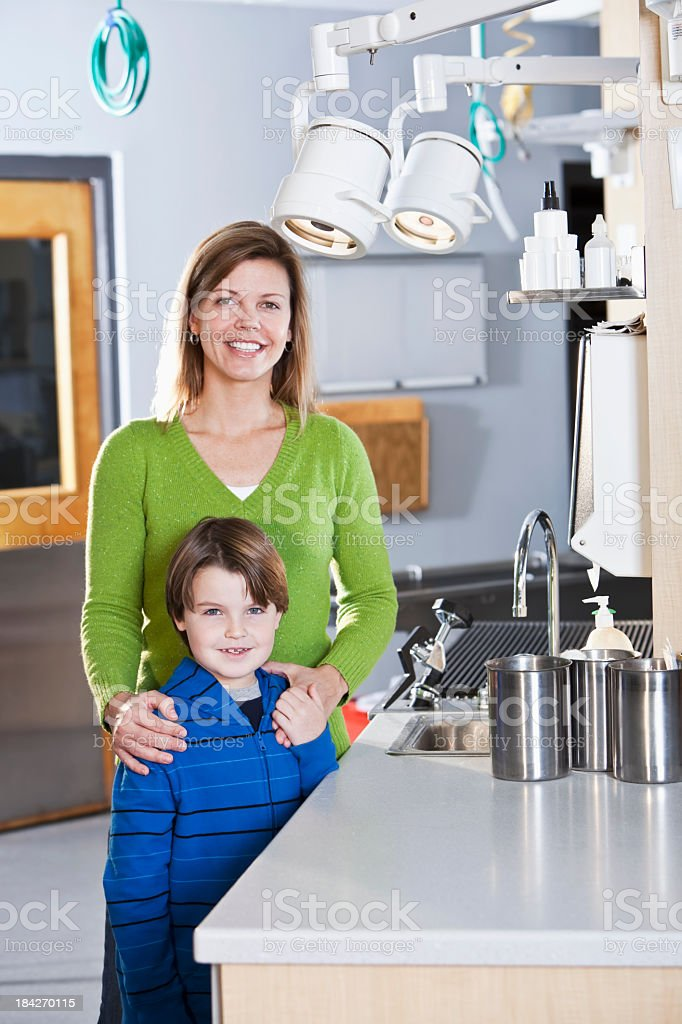 Mother and child standing in veterinarian's office stock photo