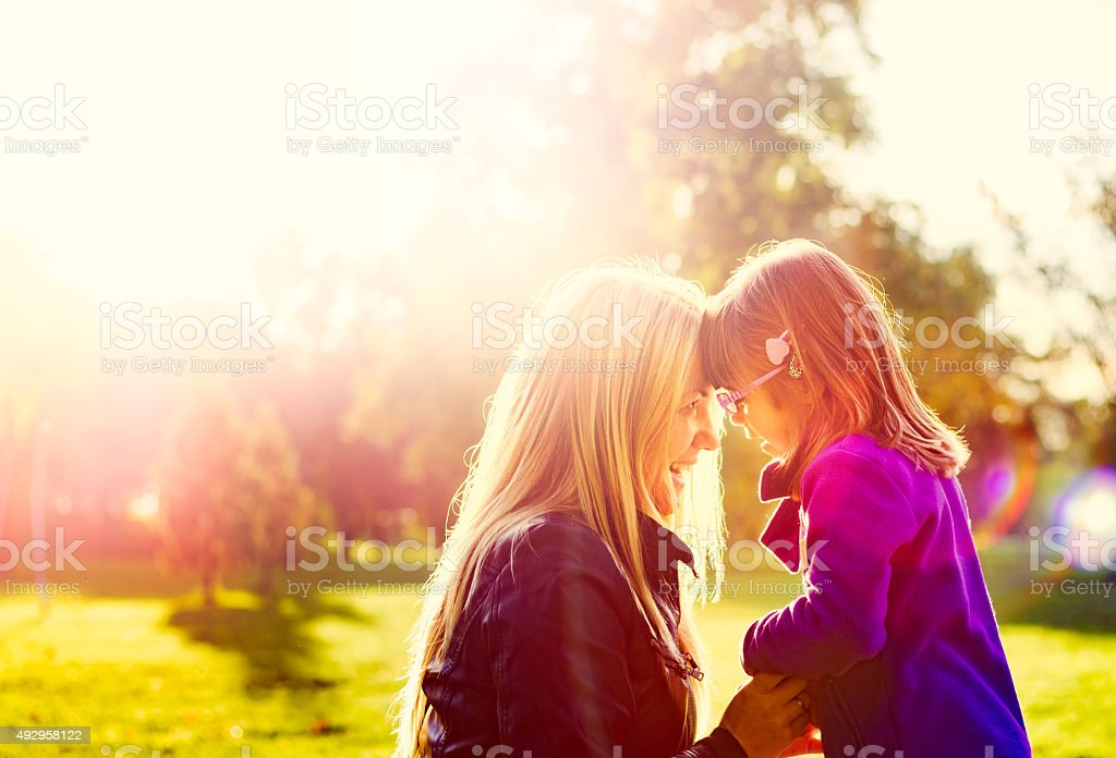 Mother and child together on sunny afternoon stock photo