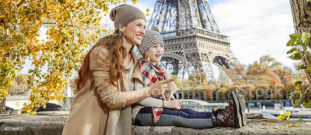 mother and child travelers in Paris pointing on something stock photo