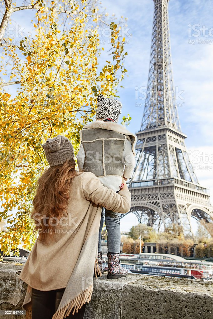 mother and child travellers looking on Eiffel Tower in Paris stock photo