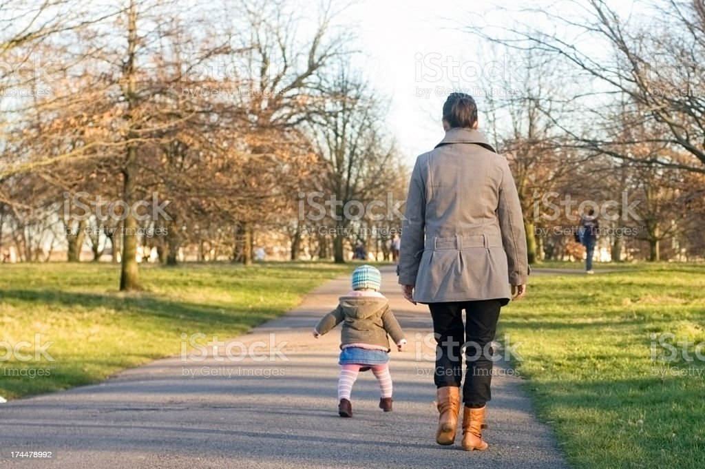 Mother and child walking in park royalty-free stock photo