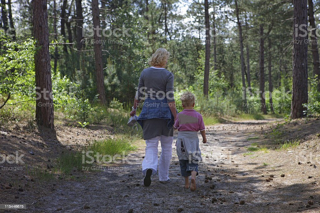 Mother And Child Walking royalty-free stock photo