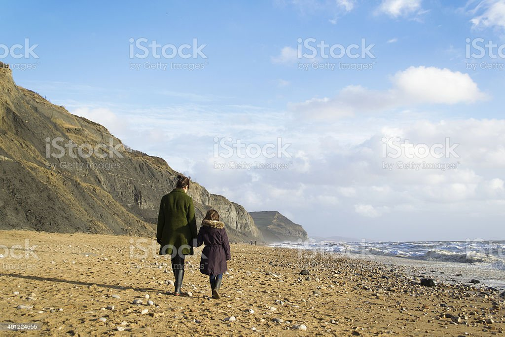 Mother and child walking stock photo