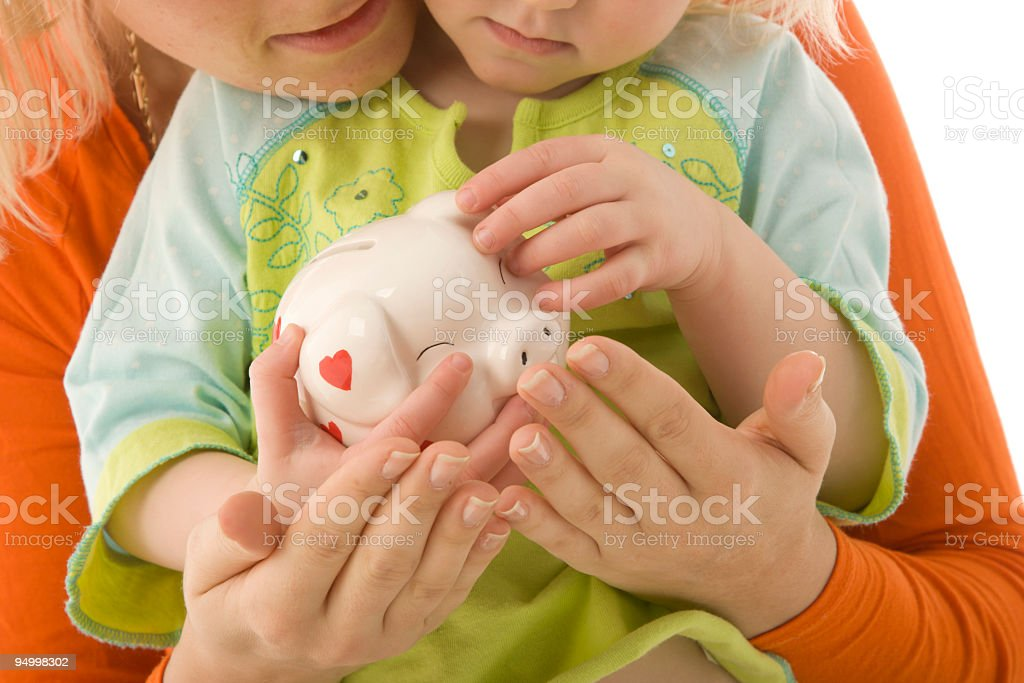 Mother and child with a piggy bank royalty-free stock photo