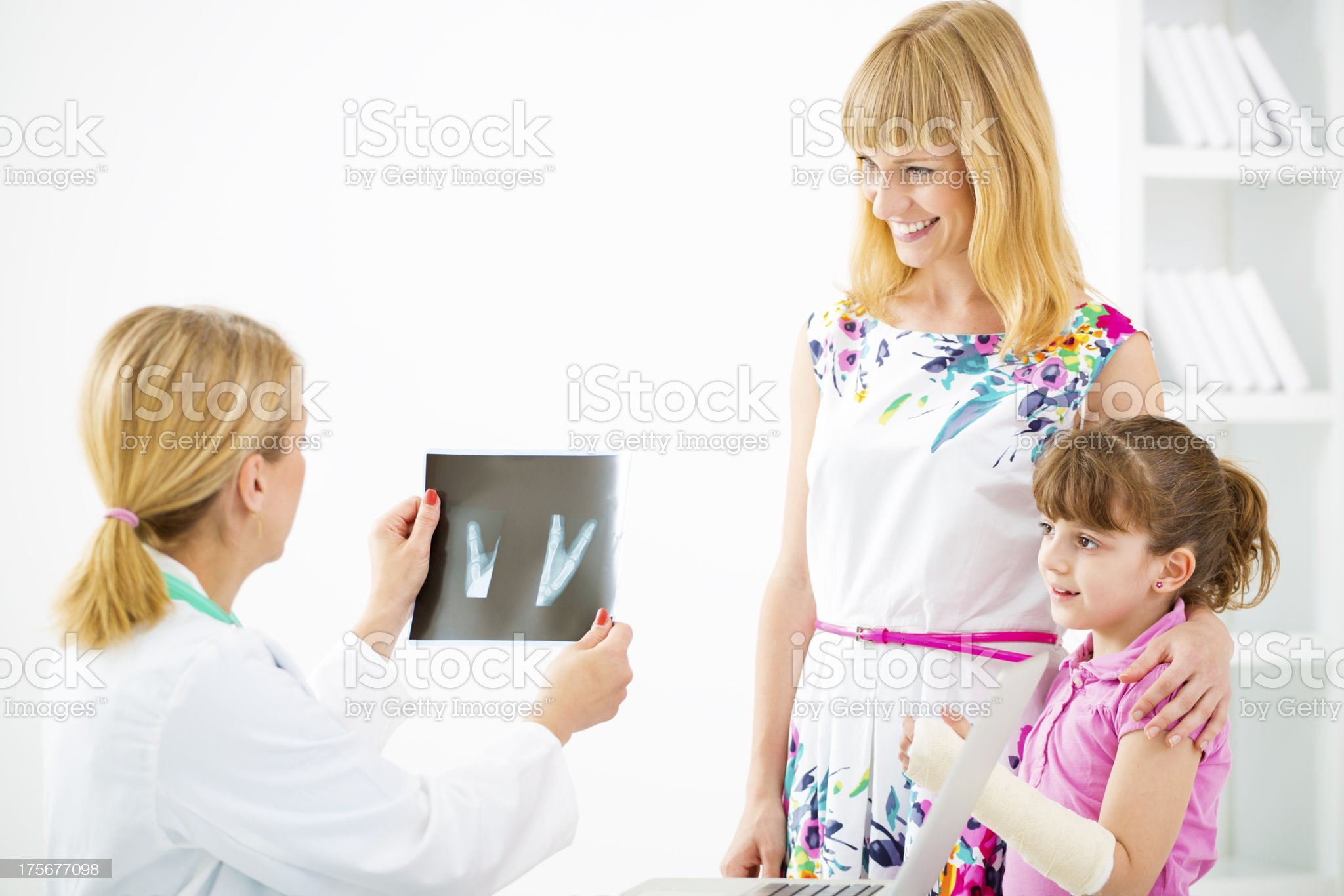 Mother and Child with broken arm At Doctors Office. royalty-free stock photo