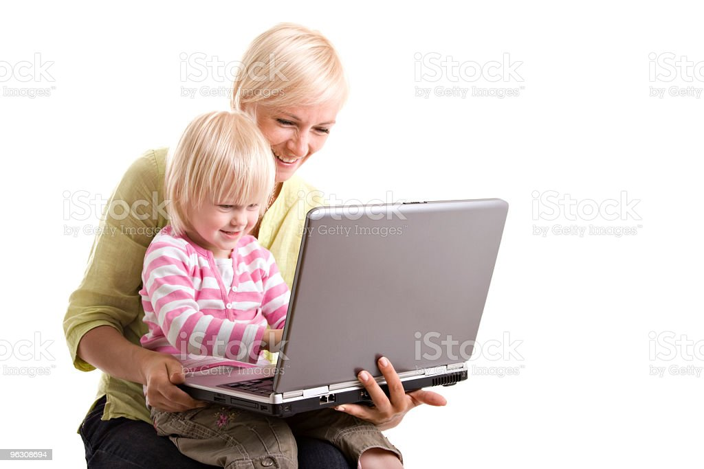 Mother and child with laptop stock photo
