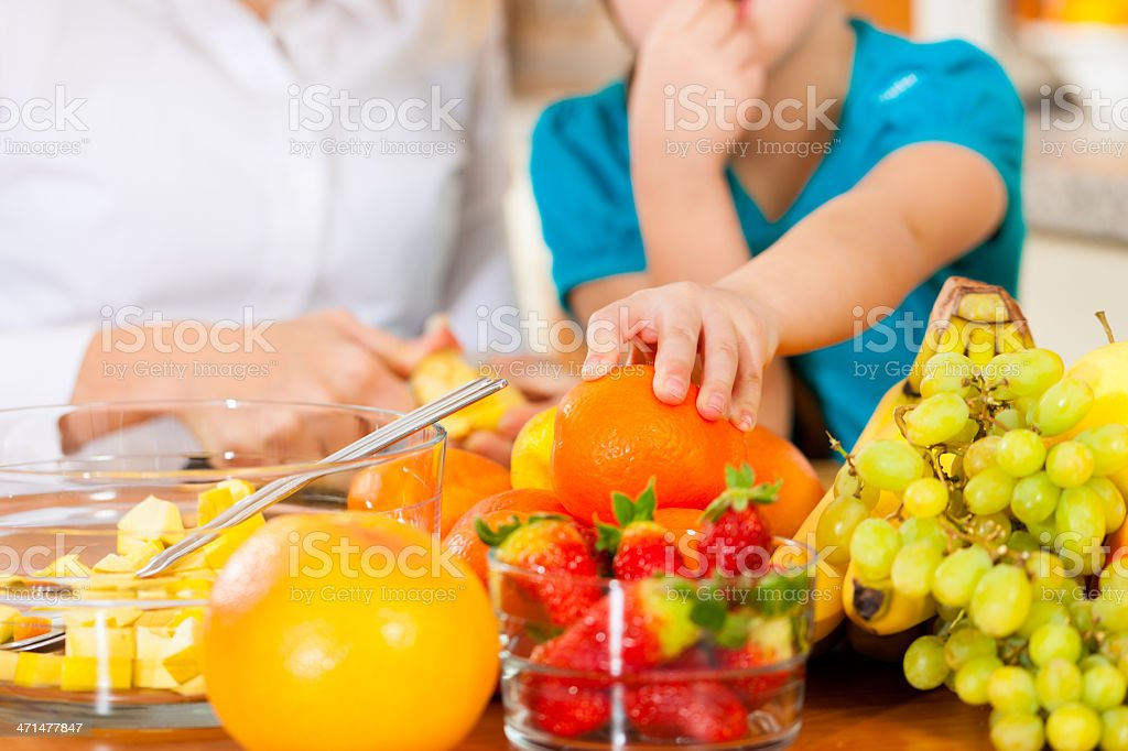 Mother and child with lots of fruits royalty-free stock photo