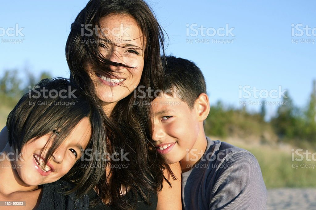Mother and Children at the Beach royalty-free stock photo