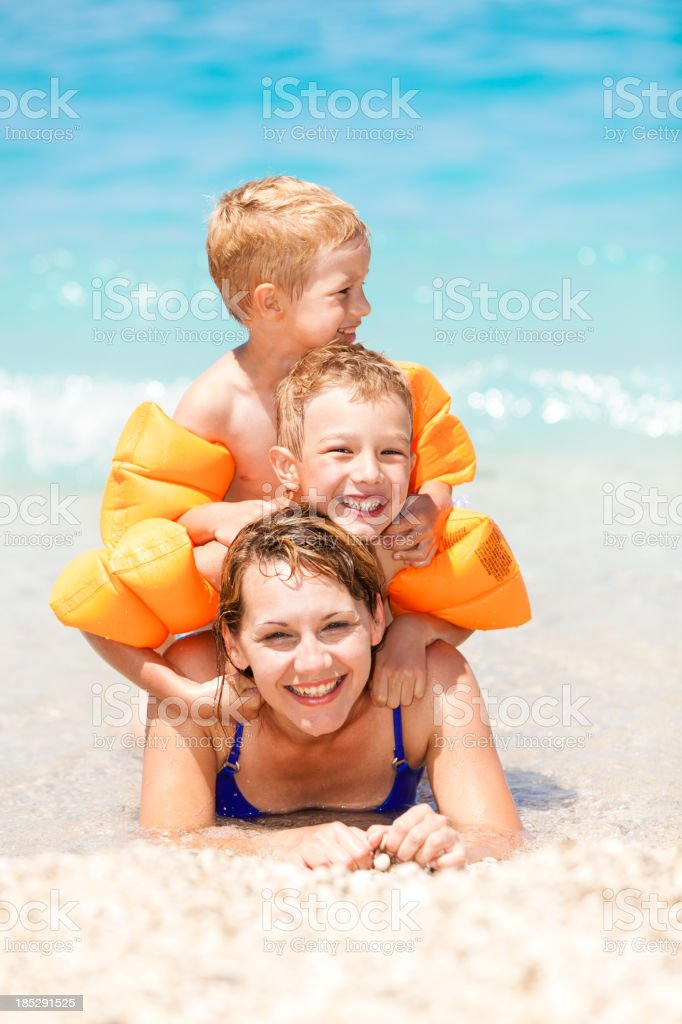 Mother and children by the sea royalty-free stock photo