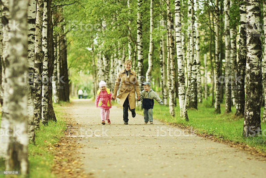 Mother and children having fun in the park royalty-free stock photo